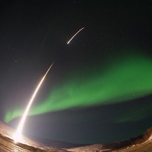 NASA rocket launched through an aurora over Venetie, Alaska. | The 33 Most Iconic NASA Images Of 2014