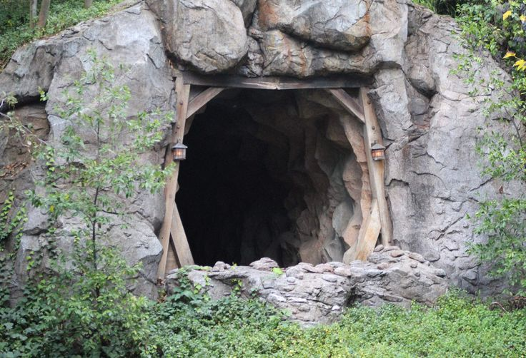 There's an abandoned mine shaft in Frontierland And until 1977, it was actually in service as part of the Rainbow Caverns Mine Train, a cargo-car train that would take you on a quarter-mile journey through the Frontierland wilderness and into an only-accessible-by-train cave with black lights, neon-colored waterfalls, and glowing pools of luminescent water. It is now boarded up, like any other out of service mine shaft.