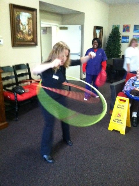 Life Enrichment Coordinator Amy McCormack shows off her double hula hooping talents.