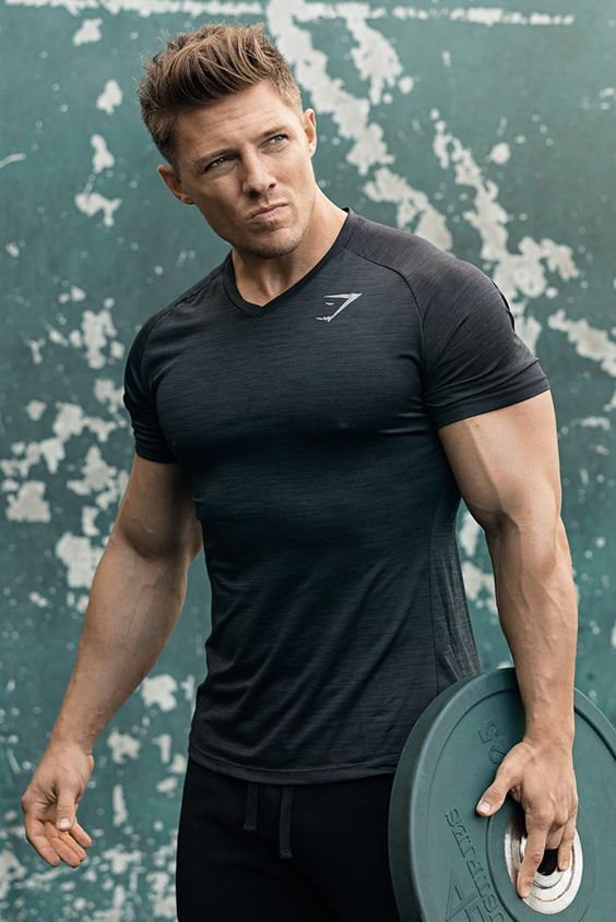 Steve Cook working out in the Convert T-Shirt in Alpine Green: