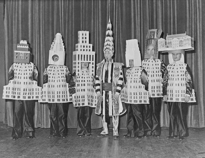 Famous architects dressed as their buildings, 1931; L-R: A. Stewart Walker (Fuller Building), Leonard Schultze (Waldorf-Astoria), Ely Jacques Kahn (Squibb Building), William Van Alen (Chrysler Building), Ralph Walker (1 Wall Street), D.E.Ward (Metropolitan Tower), Joseph H. Freelander (Museum of New York)