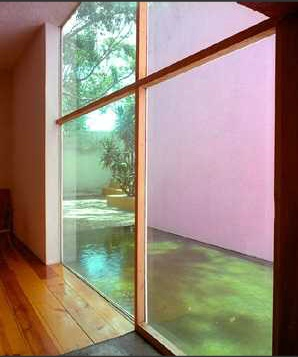 Galvez House by Luis Barragan. Small pond reflecting daylight.