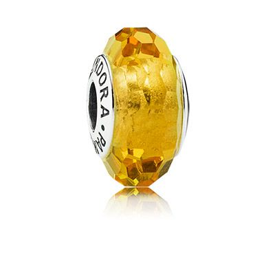 Crafted from authentic Italian Murano glass, PANDORA's popular faceted glass charm is now available in an elegant golden shade - perfect for creating sophisticated looks. $45 #PANDORA #PANDORAcharm #PANDORAaw14