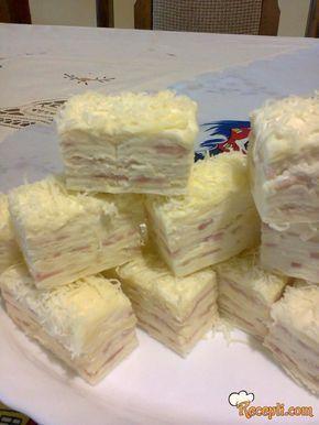Recept za Slanu Rozenku. Za spremanje slane torte neophodno je pripremiti majonez, pavlaku, krem sir, rozen korice, šunku, kačkavalj.