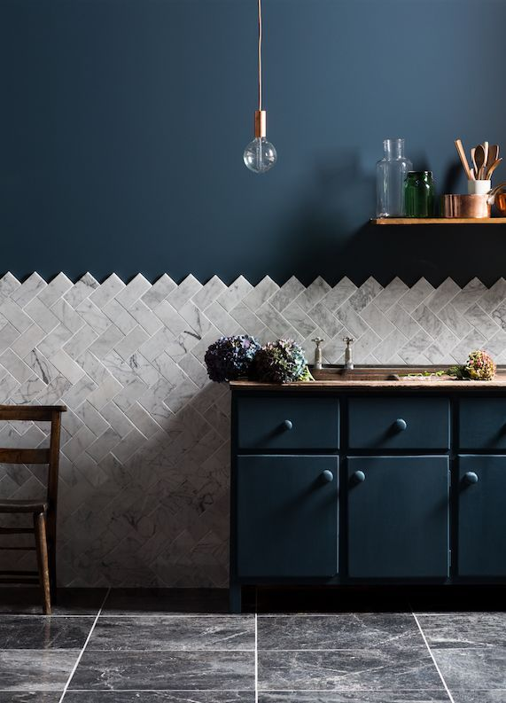 unexpected backsplash - diagonal herringbone tile with blue walls and cabinets