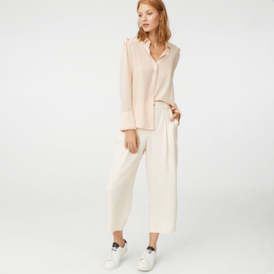 """Details, details. Artful pleated folds at the shoulder and a looped trim at the cuffs give a silk blouse a certain something. Silk Relaxed fit 22¾"""" in length, based on a size M Point collar; concealed button front closure with rounded button at the neck; folded pleats at the shoulders; button-and-loop closure with looped trim at the cuffs Dry clean Imported"""