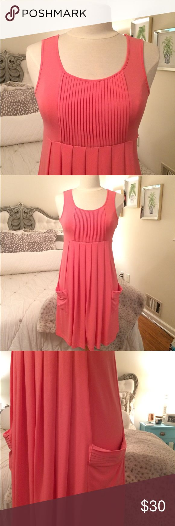 Calvin Klein Swing Dress coral • pleated with pockets • this is a great work dress! • just add a cute statement necklace - turquoise or gold would look great. • excellent used condition: worn once • freshly dry cleaned Calvin Klein Dresses
