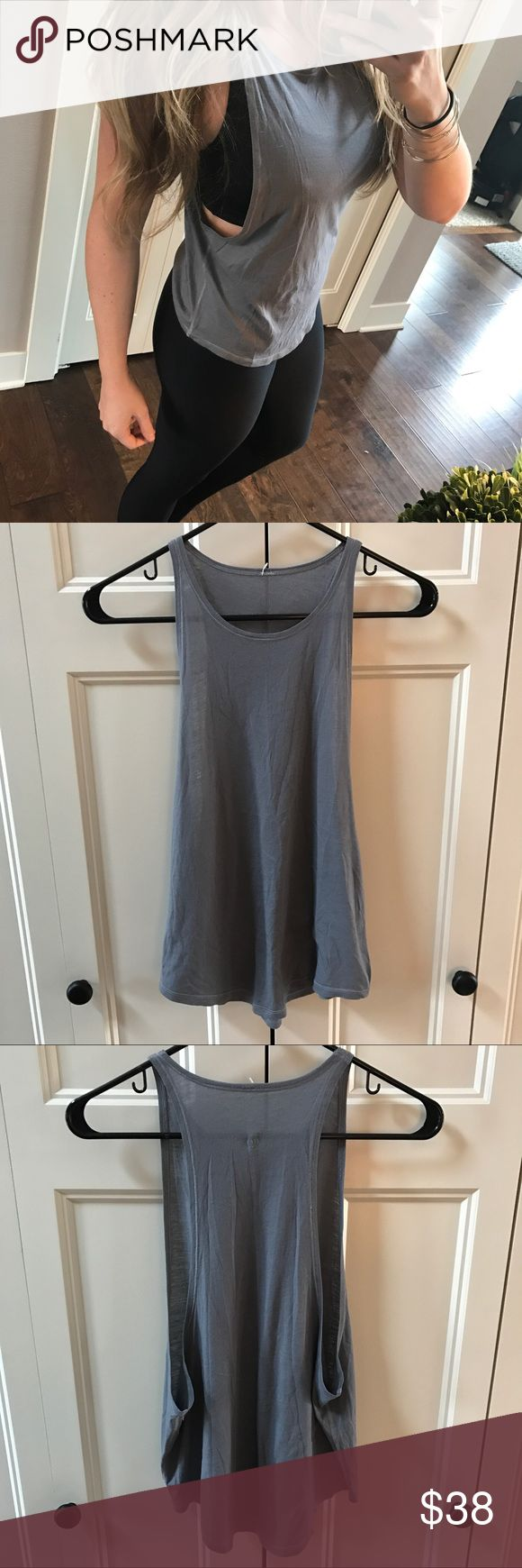 Lululemon Muscle Tank Lululemon Muscle Tank. Dark gray. Size 6. Very excellent used condition ! No trades. If you like something, please use the offer button, I may not respond to offers in comments. I play by Posh's rules. Bundle for UP TO a 25% discount as well as saving on your shipping! Play nice and happy shopping! lululemon athletica Tops Tank Tops