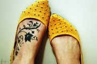 Swirl vines foot all black tattoo.  Also would be cool with a John15:5 reference.