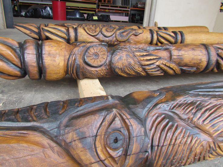 Huge carved totem poles & rope run posts