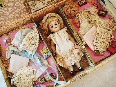 French porcelain doll with case. Love all the accessories and extra clothes!!!