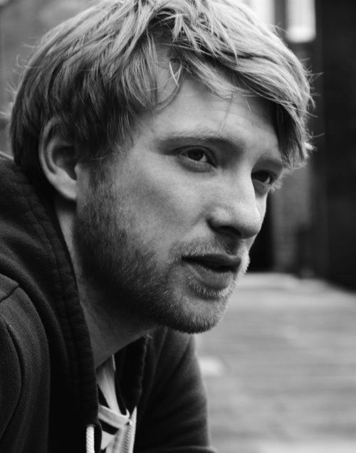 "Domnhall Gleeson<-- he is the son of the actor who plays ""Mad-Eye Moody"" and played the part of Bill Weasly in Harry Potter...Plus he is Irish ;)"
