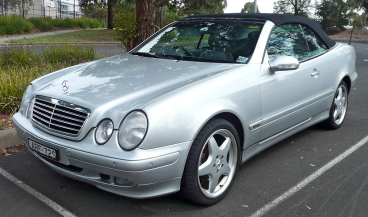 1999 Mercedes CLK 320 convertible. sigh.. I miss this car..this is a 2000 but mine is cuter..it's Periwinkle and a navy rag top..really cute and I love it as much as I did when I bought it....I used divorce money to buy it...lemons to lemonade!!!