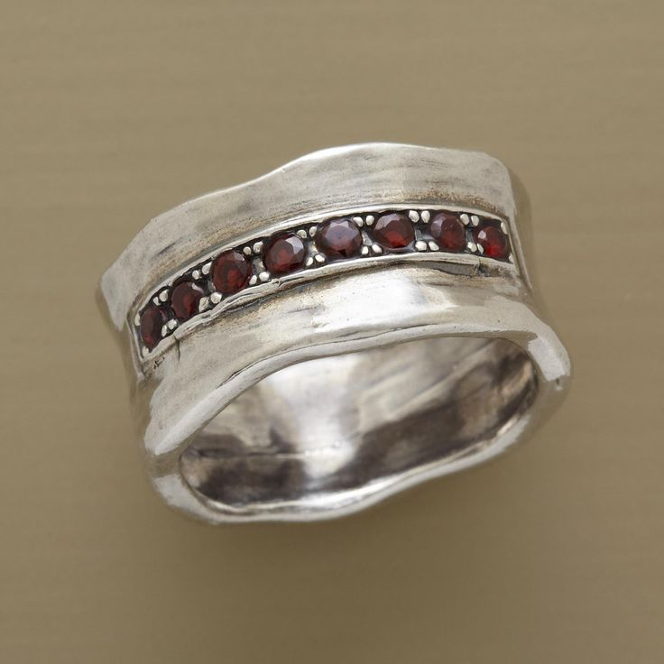 """GARNET GUARDIAN RING -- An arc of garnets, a gem said to inspire courage, caps our hefty sterling silver red garnet guardian ring. A hand-cast Sundance exclusive in whole sizes 5 to 9. Approx. 3/8""""W."""