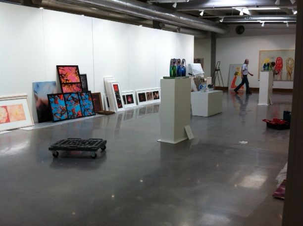 Art hanging around waiting to be hung on the wall – setting up our summer exhibition 2013.