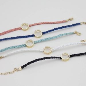 """As seen on ShopDesignSpark.com  -faux leather cord, crystal circle charm  -6-7""""L  -imported"""