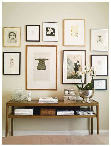 A well-designed frame wall - I approve of the art in black + dull gold frames.    photographandframe.com
