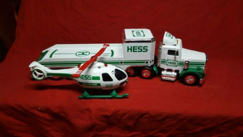 Vintage 1995 Hess Toy Truck and Helicopter. 1995 ushered in a helicopter! The 1995 Hess Toy Truck and Helicopter set were first for an air vehicle. The heli has a red single-blade rotor that whirls at the press of a button or flick of a switch! It also showcases a moveable front mounted searchlight that the kids love. It has flashing lights, and a rear spinning rotor on the tail of the chopper to boot.