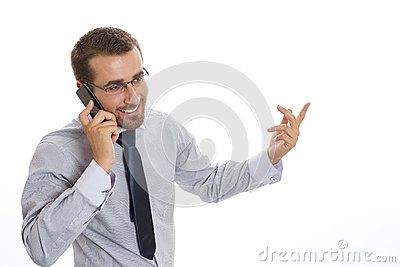 Happy young business man speaking on cellphone and gesturing with his hand, on white background.
