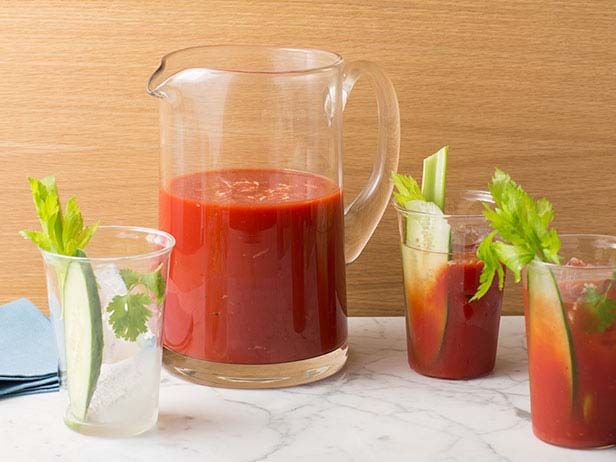 Pitcher of Bloody Marys : Tyler Florence kicks up the flavor of Bloody Marys by using pepper vodka and prepares the savory mix in a pitcher to serve a crowd.