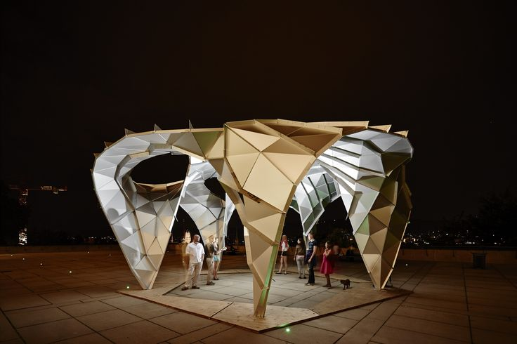 This multimedia pavilion has been developed by a group of architects under the direction of Dimitry Demin in collaboration with the ETH Chair for Computer Aided Architectural Design CAAD, led by Prof. Dr. Ludger Hovestadt.  The Rose Pavilion was designed by Dimitry Demin (architect), Jürgen S. Wassink (engineer) and Achilleas Xydis (architect and robot Support production): rose-pavilion.com