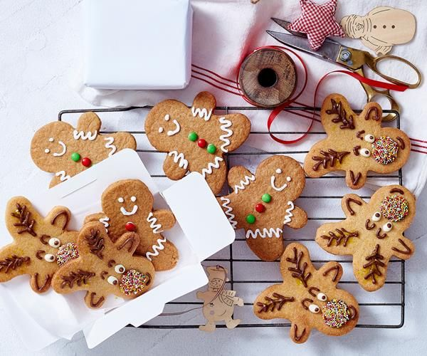 Reindeer and gingerbread men Christmas cookies recipe - By Woman's Day, These adorable reindeer and gingerbread men cookies are perfect to give as gifts at Christmas time, or to serve alongside dessert after your lunchtime spread for a cheeky sweet treat.