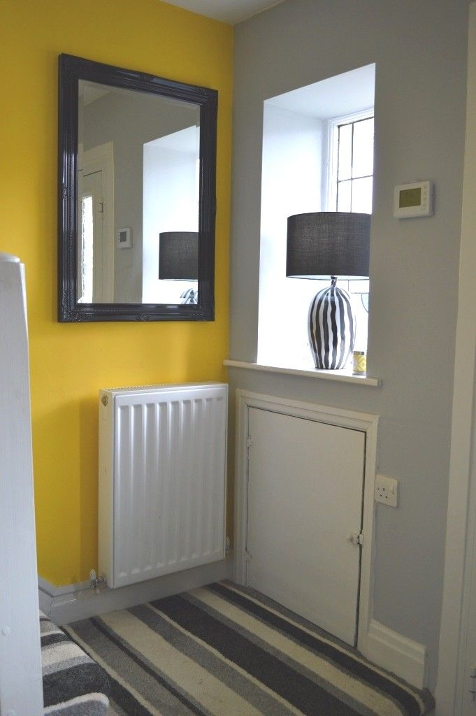 Grey and Yellow hallway with stripes galore.