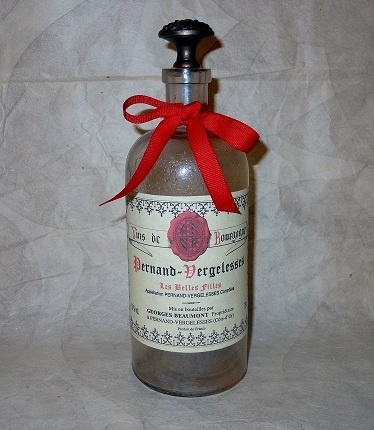 Vintage bottle decor. Farmhouse. Shabby French using real French wine labels.