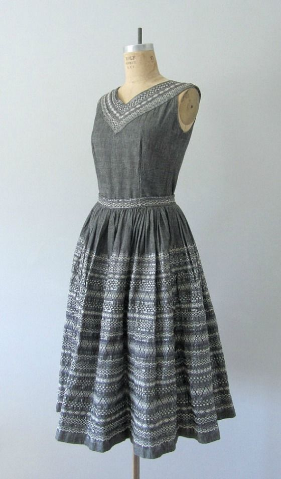 An ethnic weave on a lovely grey vintage porch dress. I like the detail at the v-neck.