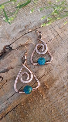 Handmade copper wire earrings with Turquoise beads I made it of recycled copper wire with natural Turquoise beads. The copper has been aged and polished to give a rich patina and depth of color. Length of the a earring is : 4 cm or 1.57 inch If you choose this one you will get beautiful and unique piece of jewelry :) You can see more in Earrings section : https://www.etsy.com/shop/Tangledworld?section_id=16481918&ref=shopsection_leftnav_2 Thank you :)