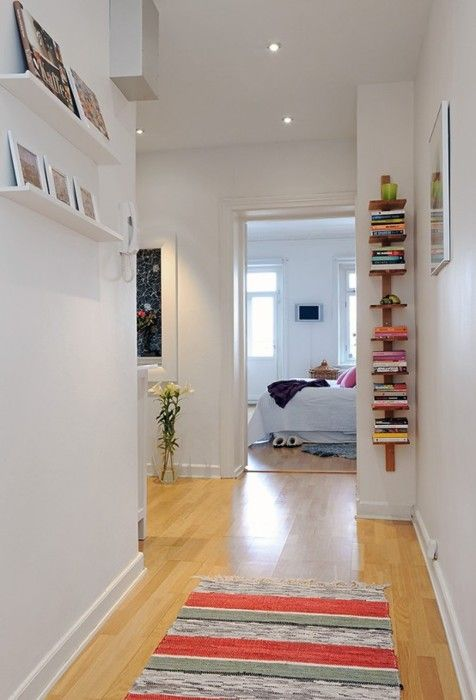 so clean, fresh, and peaceful...I love the vertical bookshelf.  I have a couple small walls that would be great for that.