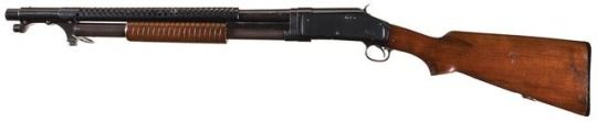 Winchester M1897 trench shotgun Manufactured by Winchester Repeating Arms Co. based on John Browning's design c.1917-45, this is a military gun made around 1941-42 - serial number E93511. 12 gauge, 5+1 shells of nine .33 caliber pellets in a tubular magazine, 20″ long barrel, pump-action repeater with an external hammer and no trigger disconnector, heat shield and bayonet lug for the standard military issue M1917 rifle bayonet. Stamped with the ordnance grenade symbol.