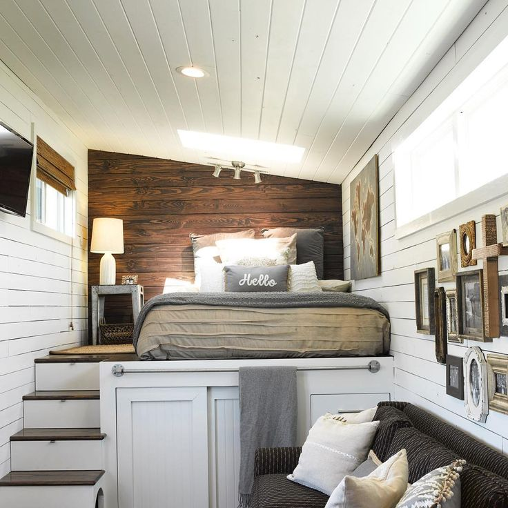 Amazing tiny home of Brian & Skyler Thomas, designed and built themselves in Mississippi over 8 months & moved to Grand Junction, CO. It's on a 35' x 8.5' gooseneck trailer. Queen bed loft is built above trailer hitch end. TV swings out for bed viewing. 6' head room at ceiling peak. Top 3 stairs w built-in drawers, bottom 2 house a dog bed. 2 sliding doors hide under-loft wardrobe closet, 4 more drawers hidden behind sofa end at right. Follow them at…