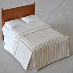 Hand-made miniature bedding and bedding kits.
