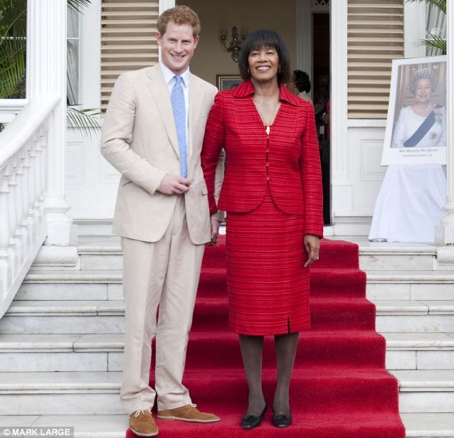 3/6/12: Prince Harry poses with Jamaica's Prime Minister, Portia Simpson Miller