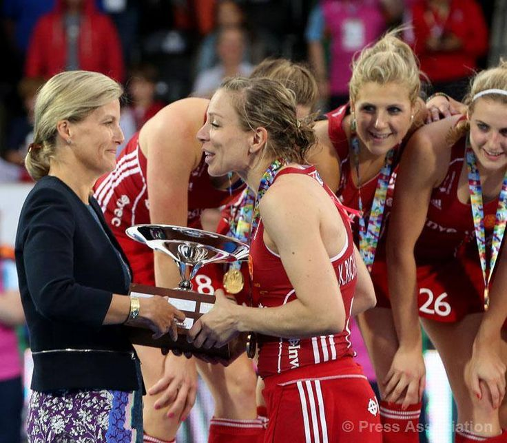 The Countess of Wessex, Patron of England Hockey, presents Kate Richardson-Walsh with the trophy after England's Women won the Gold Medal match in the 2015 EuroHockey Championships in London, 30 August 2015.