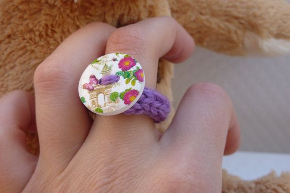 Purple ring with flower and a drawing of Paris