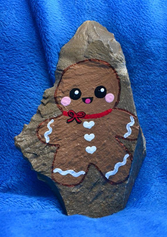 This listing is for a cute gingerbread man painted rock. This little cookie with his heart buttons has huge eyes and is waiting to complete your Christmas decorations!  ****************************************************************  Kindness Rocks! If you havent heard of the