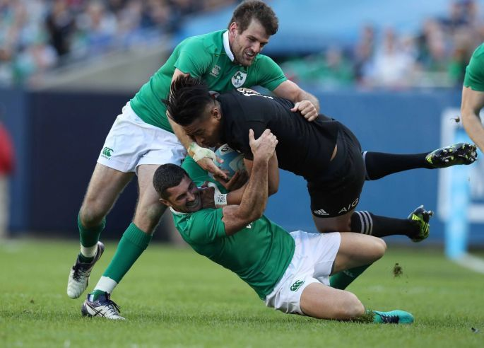 New Zealand's Julian Savea is tackled by Ireland's Jared Payne and Rob Kearney. Photo: Billy Stickland/Inpho