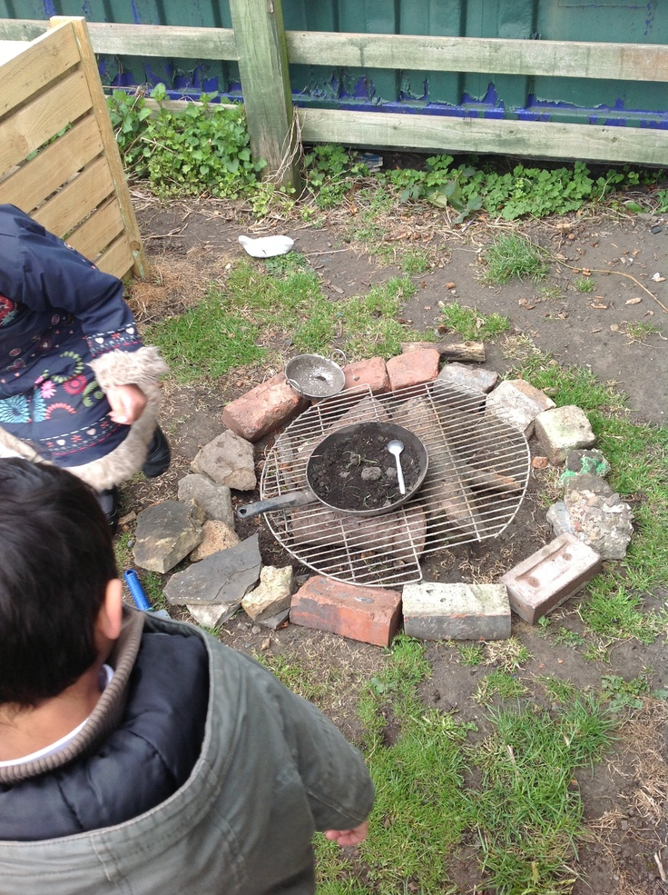 Our new BBQ/fire in the mud kitchen.