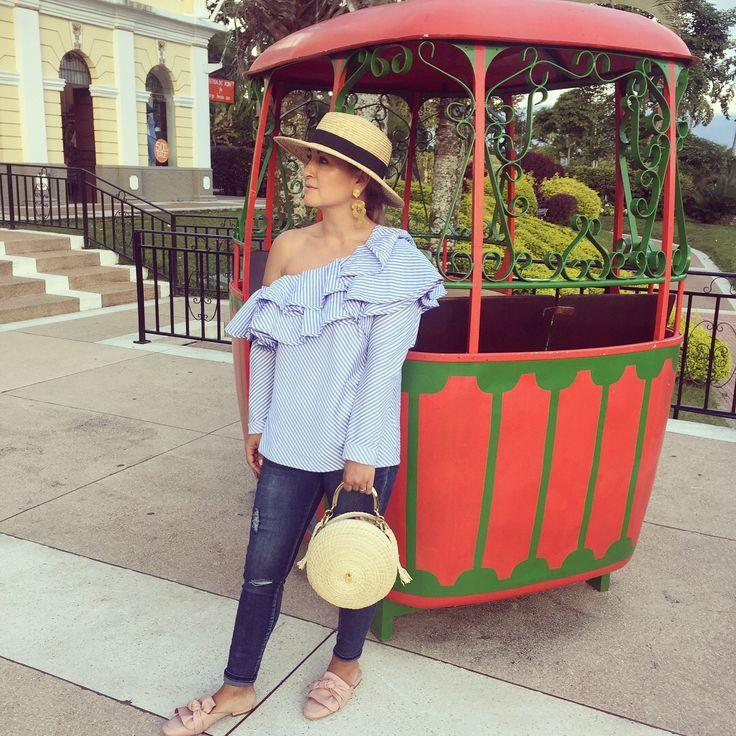 Boater hat, blue ruffled top, basket bag , parque del café Colombia