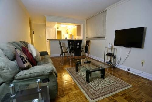 Toronto Furnished Living Bay Street Toronto Toronto Furnished Living Bay Street offers pet-friendly accommodation in Toronto. The apartment is 500 metres from Queens Park. Private parking is available on site.  The unit equipped with a kitchen with a dishwasher and oven.