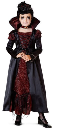 Transylvanian Vampiress Child Costume Includes dress, tiara, and choker. Does not include wig, tights, or shoes. Weight (lbs) 1.02 Length (inches) 14 Width (inches) 11.5 Height(inches) 2
