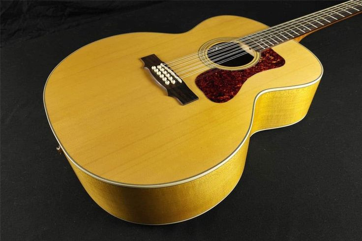 The F-2512E Maple combines two of Guild's most iconic specialties: twelve string and jumbo guitars. With their large, rounded bodies, jumbo acoustic guitars have been Guild's forte since 1954; combining this shape with the ever-popular 12-string construction results in a full-toned, impressively ...