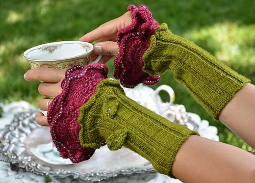 wrist warmers. Very frilly and lovely....white with pale pink might be nice