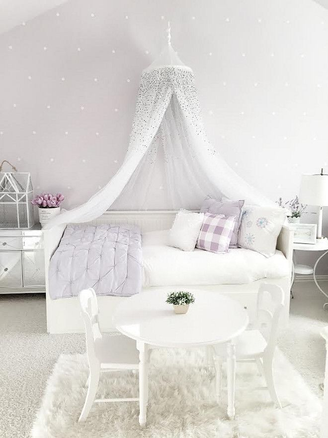 "Walls: ""Sherwin Williams Silver Peony""  Daybed: IKEA. Bedding: Pottery Barn. Kids Table and chairs: Pottery Barn. Kids Canopy: Pottery barn kids. Mirrored side table: Overstock.com White side table: IKEA. Lamp: Target. Rug: Homegoods. Wall decals: Urban Walls."