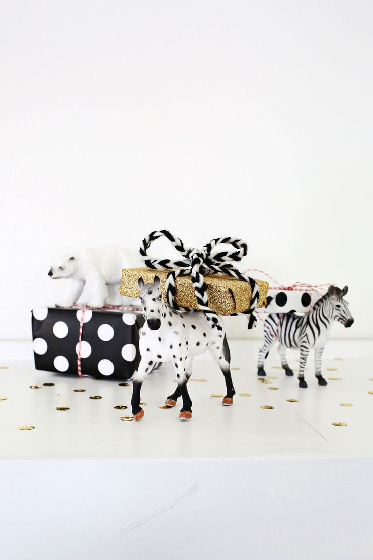 Wrap small gifts around toy animals.
