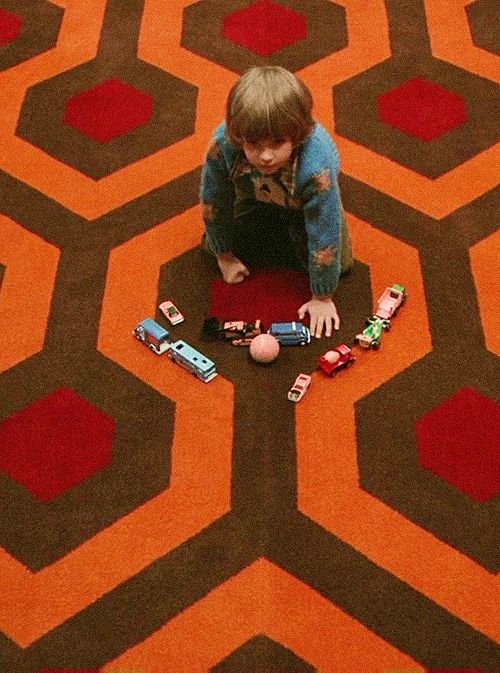 - Story - Details Ships late August. The Shining Blanket was inspired by the 1980 classic horror film by Stanley Kubrick. The scenes from The Shining at the Overlook Hotel when Danny rides his tricycl
