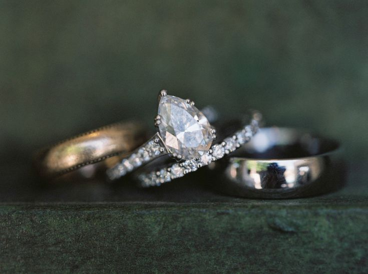 Ring shot! Beautiful pear shaped engagement ring, with grandmother's band used in ceremony.