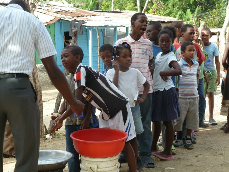 Partnering in the Dominican Republic - Word and Deed - children washing hands before receiving breakfast porridge at the breakfast program in El Cacique, a dump community just outside Santo Domingo
